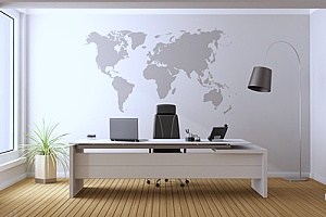 an office space that has a map printing on the wall