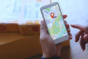 an individual using a map API with mapping software on a smartphone