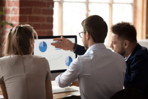 employees of one of the nonprofit organizations analyze the mapping software data