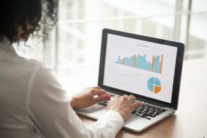 sales consultant uses data from franchise territory mapping software to create charts